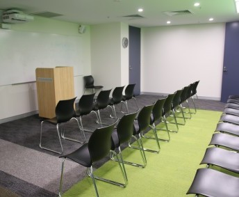 MIDDLE SCHOOL LECTURE ROOM (S415): Green room filming facilities, as well as theatre style moveable seating with projector screen. Also a lectern, great for speeches or films.