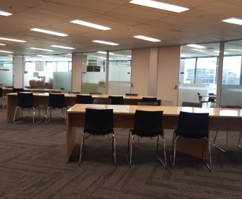 SENIOR SCHOOL OPEN STUDY AREA: tables and chairs for two classes, including access to 14 computers