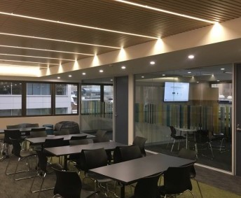 MIDDLE SCHOOL READING AREA (S421A): Seating for 24 students, situated near the non-fiction collection. Two screen with access to Apple TV or laptop connection for staff. Can be used in conjunction with the two study rooms next to space. Beanbags and other seating options available.