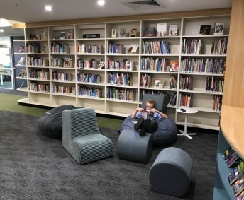 MIDDLE SCHOOL READING AREAS: Scattered throughout the library, with various seating options for students. Classes can spread out and use these areas when booking any of our library spaces.